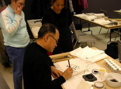 Baoxing Zhang shows how to create the pig in a few strokes